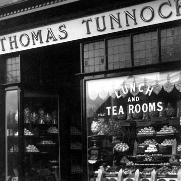 1924 Archie opens larger tearooms